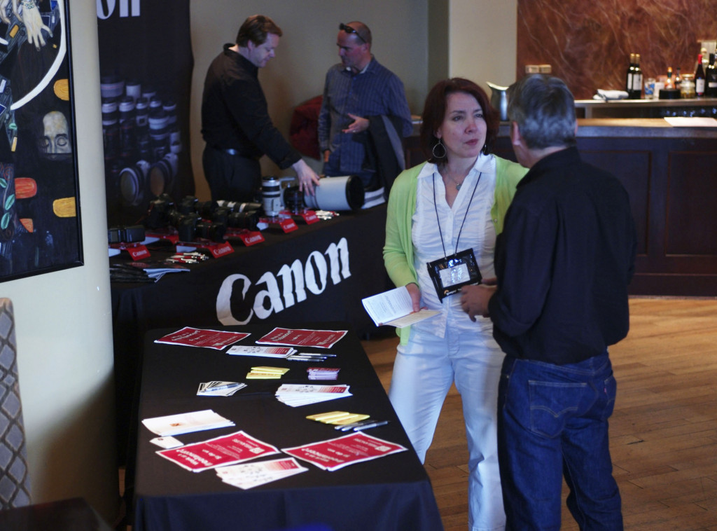 Rebecca Hass speaks with a photographer at the NPAC conference last month in Vancouver.  Photo courtesy of Andy Clark